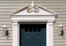 Decorative Door Trim with Pediment and Fluted Pilasters